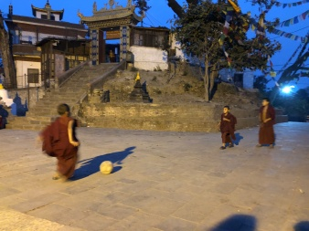 Monks playing football at Swayambunath